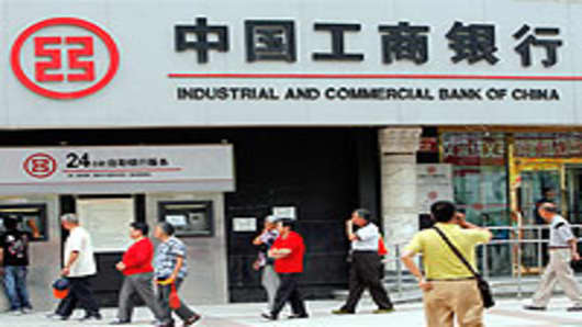 Pedestrians walk past a branch of the Industrial and Commercial Bank of China (ICBC) in central Beijing.