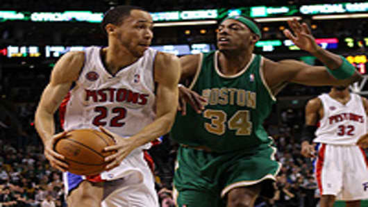 Tayshaun Prince #22 of the Detroit Pistons heads for the net as Paul Pierce #34 of the Boston Celtics.