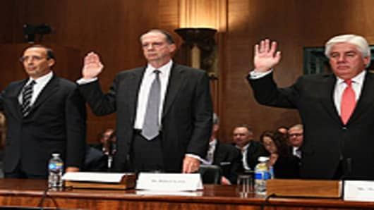 Robert E. Lewis, Senior Vice President and Chief Risk Officer, American International Group(center), being sworn in during a Financial Crisis Inquiry Commission (FCIC) hearing on Capitol Hill in Washington, DC.