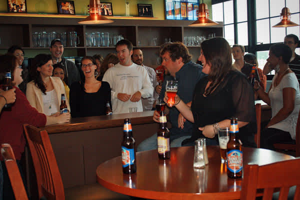 "The Boston Beer Company, which makes Samuel Adams beers and trades under the stock symbol ""SAM,"" wants its employees to know and love its products. And what better way to do that than to give them away for free? All 700 employees nationwide get two free cases of a beer of their choosing, every month. And, at headquarters in Boston, monthly ""Cake and Beer"" parties are held to celebrate the birthdays of employees born that month. Guess where those parties are held? In ""Sammy's Place,"" the bar that"