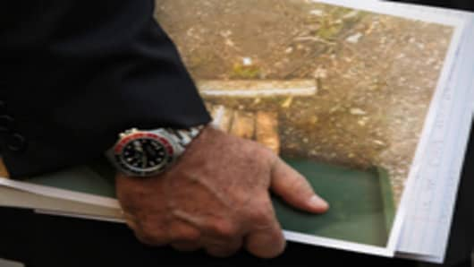 New York City Police Commissioner Raymond Kelly holds a picture of eight sticks of military-grade explosives which were discovered at the Marble Cemetery on October 11, 2010 in New York City.