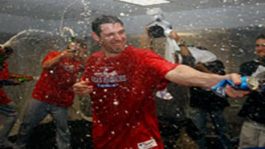 Texas Rangers celebrate the victory over the Tampa Bay Rays in Game 5 of the ALDS at Tropicana Field on October 12, 2010 in St. Petersburg, Florida.