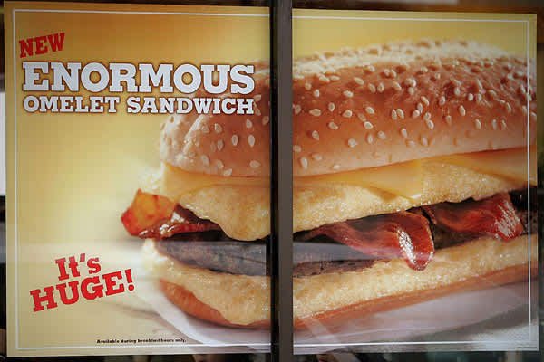 Anyone who thought that fast food breakfasts were too health-conscious was happy on March 28, 2005, when Burger King launched the Enormous Omelet Sandwich. The product consisted of eggs, cheese, bacon and sausage on a sesame seed roll, and if its 330 milligrams of cholesterol and 1940 milligrams of sodium didn't shut down your arteries, there was always the Meat'normous Omelet Sandwich, which added ham. At first, the sandwich boosted Burger King's sales of breakfast by 20%. However, the novelty