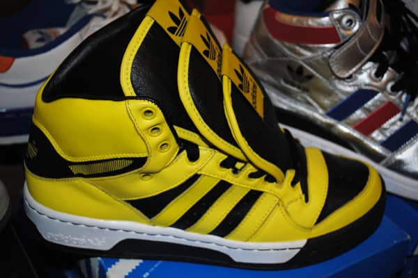 : $250 Adidas sneakers designed by Jeremy Scott are highly sought after by shoe fans. The eccentric fashion designer, who has worked with the company since 2009, created this yellow and black pair that has three tongues over the laces. This design can run up to $450, says collector Carpice Morgan, but she was selling them for less because they were in a less desirable small Men's size.