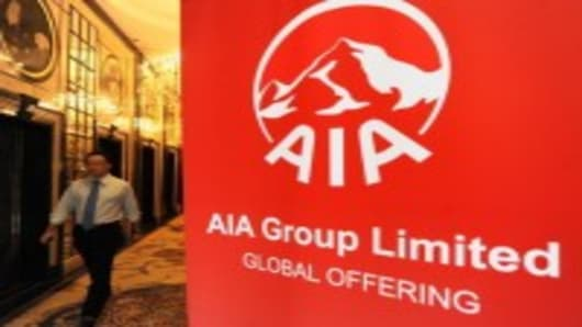 People arrive for the AIA group limited global offering in Hong Kong on October 6, 2010.