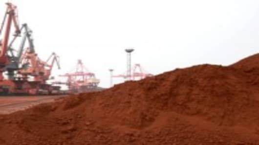 Bulldozer scoop soil containing various rare earth to be loaded on to a ship at a port in Lianyungang, east China's Jiangsu province in September, for export to Japan.