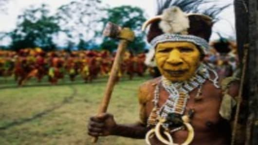 Papua New Guinea Warrior Holding Axe