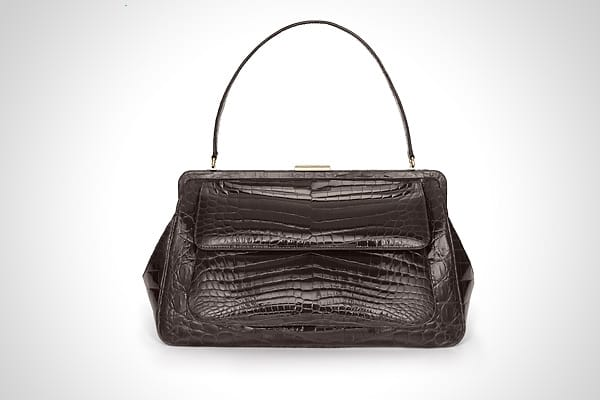 Cost: $16,500 Although many women probably feel as though they can never have too much jewelry, this year it might be worth going to Tiffany's for something else. There's a lot of buzz building about the retailer's new handbags and leather goods. This handle-framed bag features glazed espresso-colored crocodile and 24-karat gold-plated brass hardware. The bag is lined with Tiffany Blue leather, with interior pockets, a zipper compartment, and a key ring. While this bag is a splurge, there also a