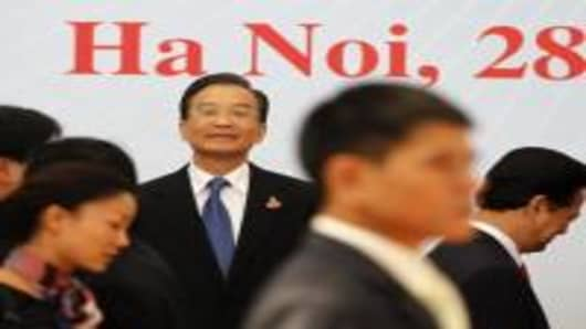 China's Premier Wen Jiabao waits for other leaders to arrive for a group photo during the 16-nation East Asia Summit, which the US is attending for the first time along with Russia, on the sidlines of the 17th Association of Southeast Asian Nations (ASEAN) Summit in Hanoi October 30, 2010.