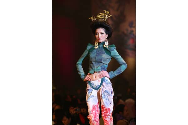 A model showcases designs on the catwalk during the BOTAO collection show on the second day of China Fashion Week Spring/Summer 2011 on October 25, 2010 in Beijing, China.