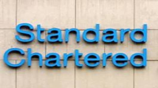 This shows the logo outside the Standard Chartered bank in the Central district of Hong Kong, 22 September 2003.