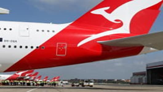 This file photo taken on September 21, 2008 shows the first Qantas Airbus A380 passing the Qantas fleet at Sydney International Airport after two years of production delays and 200 million USD in compensation. Australian flag-carrier Qantas on August 19, 2009 posted an 88 percent drop in annual net profit to 96.6 million USD and unveiled a massive cost-cutting plan to counter the financial beating.