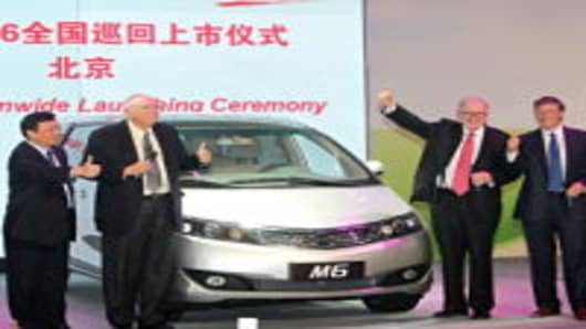 Wang Chuan-Fu, the Chairman and President of BYD, Berkshire Hathaway CEO Warren E. Buffett, Vice-Chairman Charles Munger and Bill Gates, founder of Microsoft, attend a new product launching conference of BYD at China World Hotel on September 29, 2010 in Beijing, China.