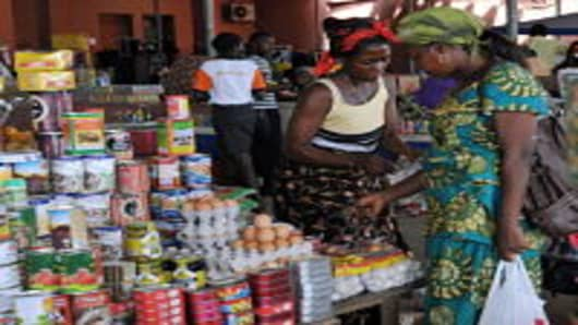 An Angolan woman shops in a market in Cabinda.