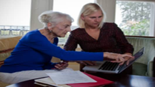 elderly woman with financial advisor