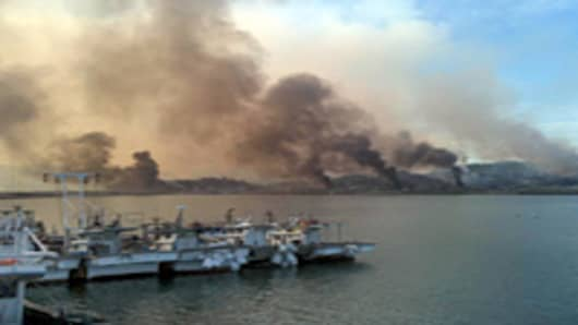 Picture taken by a South Korean tourist shows huge plumes of smoke rising from Yeonpyeong Island in the disputed waters of the Yellow Sea on November 23, 2010.