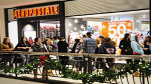 Shoppers wait to enter the Aeropostale store during 'Midnight Madness' at the Tyson's Corner Center in Tyson's Corner, Virginia.