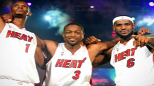 (L-R) Chris Bosh #1, Dwyane Wade #3, and LeBron James #6 of the Miami Heat are introduced at the HEAT Summer of 2010 Welcome Event at AmericanAirlines Arena on July 9, 2010 in Miami, Florida.