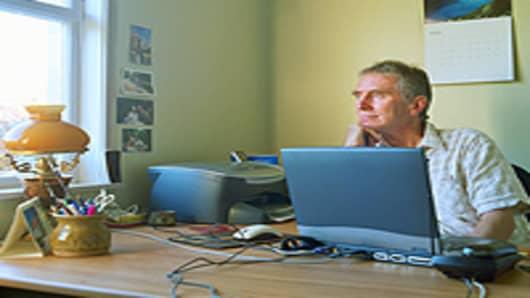 man_pensive_desk_200.jpg