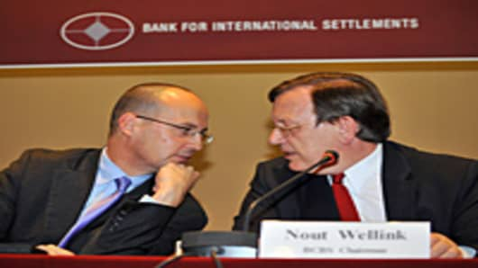 BCBS chairman Nout Wellink talks with BCBS secretary general Stefan Walter