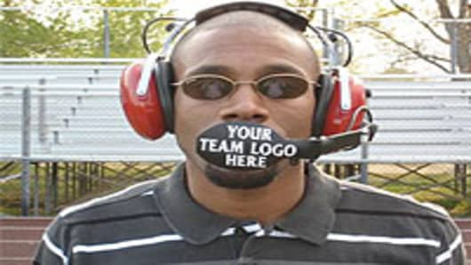 Inventor, Ramone Ward with his patented BoomGuard microphone shield for sports that require headsets.