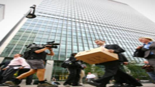 A man carries a box after leaving the Lehman Brothers European Headquarters building in Canary Wharf in east London on September 15, 2008.