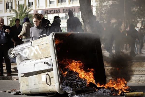 Students set a rubbish container on fire during a demonstration on December 22, 2010 in Palermo.Rallies across the country came just over a week after protest clashes in the centre of Rome that injured nearly 200 people and saw cars set alight and tear gas fired in some of the most tourist-heavy streets of the Italian capital.
