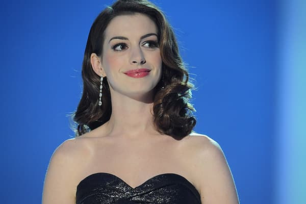 """In 2008, the Quigley Publishing Company designated Anne Hathaway their """"Star of Tomorrow,"""" a rising star with great future earning potential. Today, she makes her debut on the list at number ten, thanks to her appearances in the romantic comedy Valentine's Day, Love and Other Drugs and Tim Burton's 3D adaptation of Alice in Wonderland. Although all three films received mixed reviews, critics praised Hathaway's performances in each of them, and altogether, they earned over $475 million at the US"""