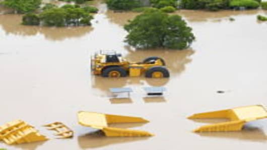 Mining equipment is submerged by flood waters on January 6, 2011 in in the central Queensland city of Rockhampton, Australia.