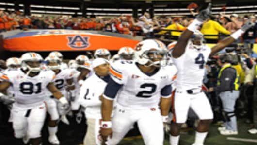 Auburn Tigers entering the football field.