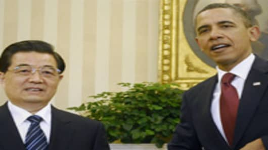President Obama and his Chinese counterpart Hu Jintao before holding a bilateral meeting in the Oval Office.