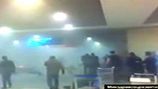 A smoke-filled corridor after an apparent suicide bomb explosion at Domodedov airport in Russia.