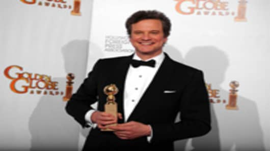 Actor Colin Firth poses with his award for Best Performance by an Actor in a Motion Picture (Drama) for 'The King's Speech'.