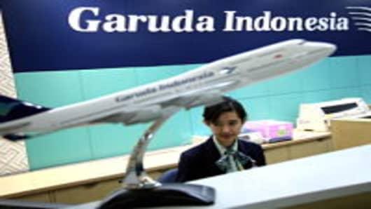 A Garuda ground staff member prepares tickets at the Garuda Indonesia airline ticket office in Jakarta.
