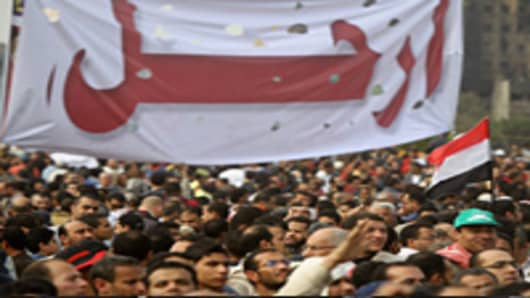 Thousands of demonstrators gather near a huge banner reading 'leave' in Arabic at Cairo's Tahrir Square as massive tides of protesters flooded Cairo for the biggest outpouring of anger yet in their relentless drive to oust President Hosni Mubarak's regime.
