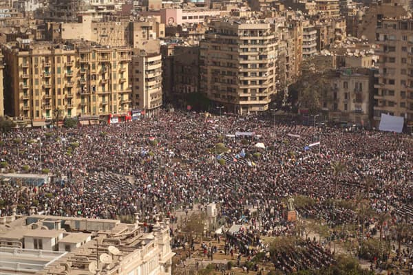 Protestors gather in Tahrir Square on February 1, 2011 in Cairo, Egypt. The Egyptian army has said it will not fire on protestors as they gather in large numbers in central Cairo demanding the resignation of Egyptian President Hosni Mubarak.