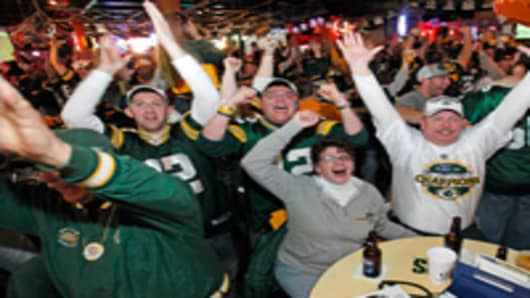 Green Bay Packers fans react after watching the Green Bay Packers defeat the Pittsburgh Steelers in the Super Bowl at Stadium View Bar.