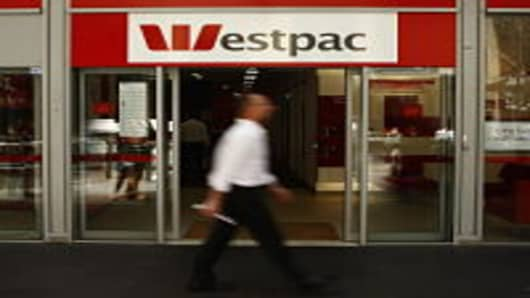 A Pedestrian walk past a Westpac branch in Sydney as economists wait to see if The Reserve Bank of Australia cut official interest rates today, at the RBA on February 3, 2009 in Sydney, Australia. The RBA are expected to cut rates by up to 1 percent this afternoon, taking rates down to 3.25 per cent, with further cuts already being discussed for next month. The rate cut would put pressure on the top four Australian banks to follow suit and cut their rates on the back of recently announced huge p