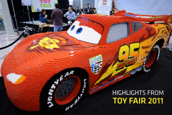 "Toy land is a happier place these days. After logging its first sales gains since 2006, the toy industry is heading into 2011 more optimistic about the year ahead. The upbeat tone was felt at the the largest toy trade show in the Western Hemisphere, which took place at the Javitz Center in New York City. Attendance at the show was up quite a bit both in terms of the people walking the booths and those showing their wares. The coming year will bring a number of toy-friendly movies such as ""Cars 2"