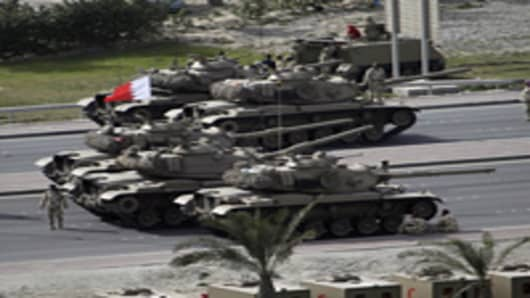 Bahraini army tanks take position near Pearl Square in Manama.