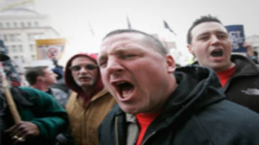 Bill Box screams while protesting against Senate Bill 5 during a rally against a pending budget bill at the Ohio Statehouse.