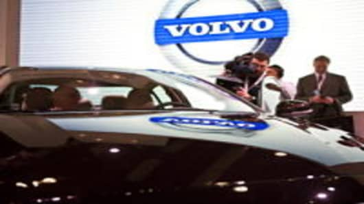 Members of the media inspect Volvo's latest model, Volvo S60, during the New York Auto International Show in New York City in 2010.