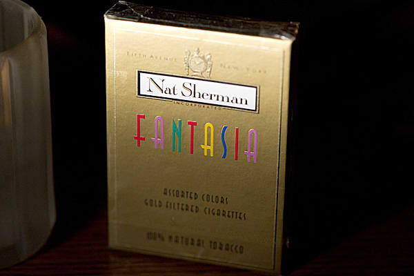 Price: $14/20 packManufacturer: Nat ShermanDistributor: Nat ShermanSize: 101 mm, Queen Size Natural Tobacco CigaretteDesign: Gold filter tip w/charcoal filter in five colorsInspired by Nat Sherman company matriarch, Lautia Sherman, Fantasia provides a charcoal filter and all natural tobacco, creating a truly unique smoking experience. The cigarette features a gold filter tip and comes in an array of five colors.
