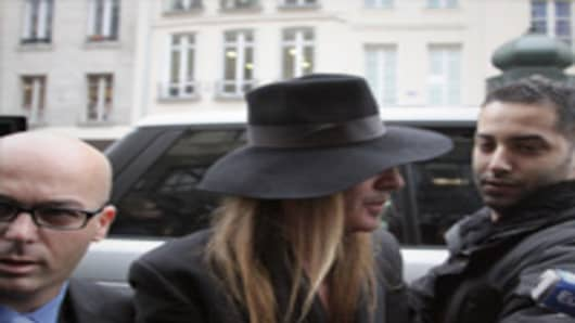 ohn Galliano and his lawyer Stephane Zerbib arrive at a police station .