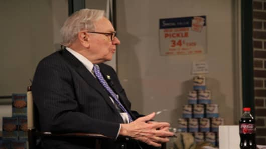 For his live appearance on CNBC's Squawk Box, Warren Buffett sat in front of an Omaha museum's mock-up of his great-grandfather's grocery store.