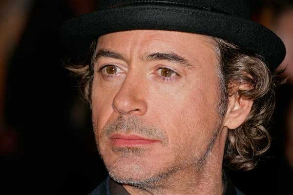 "In 1987, Robert Downey Jr. starred in Less Than Zero and won widespread praise for his portrayal of a cocaine addict. Few people knew it at the time, but Downey was already a heavy drug user himself, and by the 1990s his arrests for possession and his stays in treatment facilities became too frequent to ignore, and his once-promising career became unsustainable. In a 1999 court appearance, the actor stood before a judge and described his ongoing drug use in alarming terms: ""It's like I have a lo"
