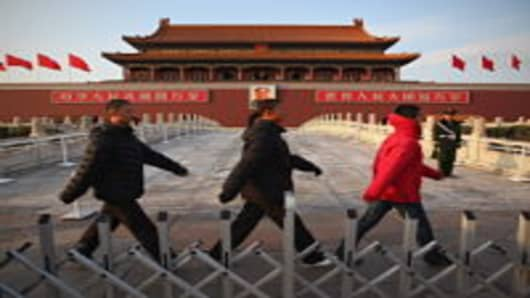 Security personel pass by the Tiananmen Gate in Beijing, China. The Chinese People's Political Consultative Conference began on March 3 in Beijing.