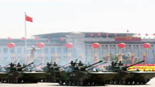 Chinese tanks rumble pass Tiananmen Square during a massive parade to celebrate the 60th anniversary of the founding of the People's Republic of China.