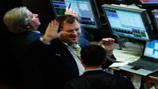 traders_high_five_240.jpg