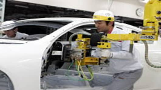 An employee of Nissan Motor Company works on the assembly line at Nissan's Global Production Engineering Center (GPEC) on May 29, 2007 in Zama, Japan. The GPEC in Zama City is one of several training and development centres established by Nissan in order to train Nissan?s global manufacturing employees to become experts in the 'Nissan Production Way'; improving technology and production efficiency worldwide.